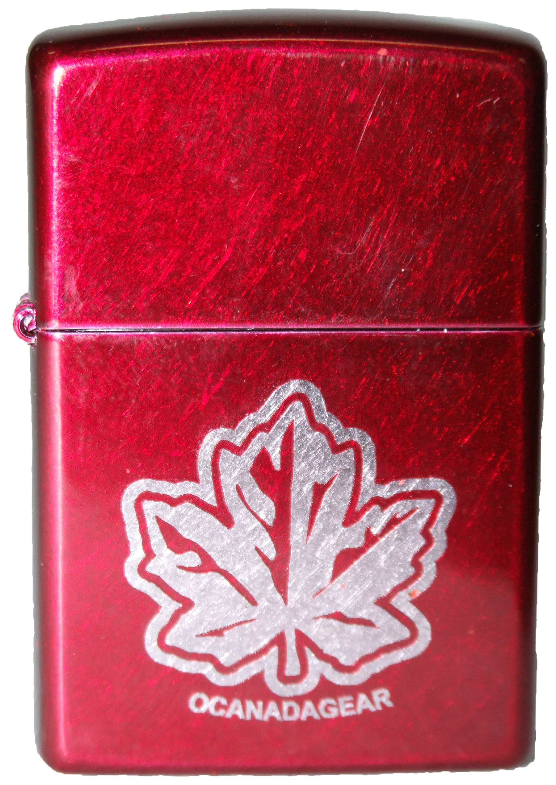 World Map Zippo Lighter. Unique to O Canada Gear  this traditional Zippo lighter with laser engraved maple leaf is one of our finest collectibles Candy apple red coating on brushed OCG Maple Leaf Lighter
